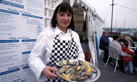 Woman serving oysters Oyster Festival Falmouth