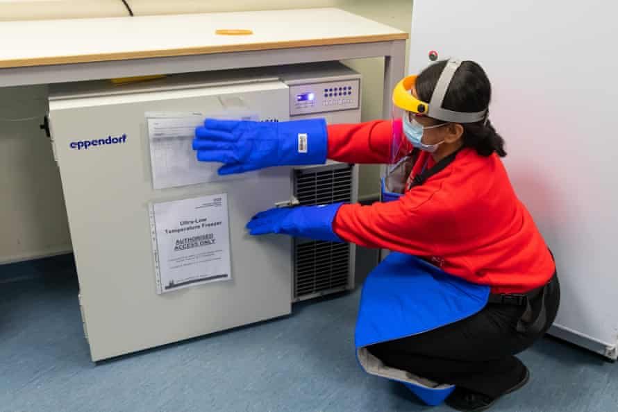 Santosh Kalair, senior pharmacy operations manager, retrieves the vaccine from the freezer.