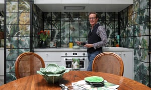 Flower power: Neil McLachlan in the kitchen area of his flat.