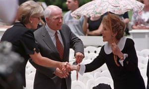 John McCain with his wife Cindy (left) and former first lady Nancy Reagan in June 1998