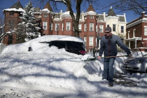 John Mexner shovels out his vehicle in Washington