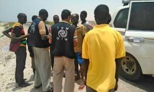 Staff assist Somali and Ethiopian migrants