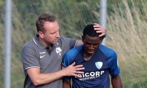 The Bochum sporting director, Sebastian Schindzielorz, consoles Jordi Osei-Tutu after the incident against St Gallen.