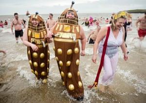 New Year's Day swim, people in fancy dress splash around in the sea