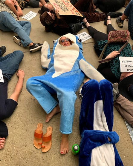 Climate protesters staged a 'die-in' at the Queensland Museum in Brisbane as part of the Extinction Rebellion events held around the world