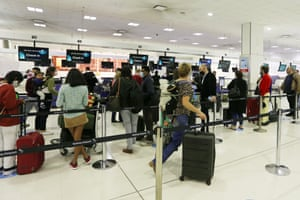 Passengers check in for Air New Zealand Flight 246 to Wellington.