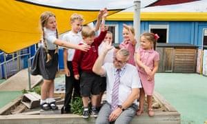 headteacher with children in playground