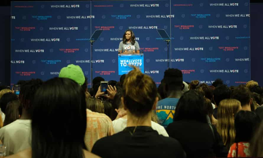 Michelle Obama talks to the crowd about the importance of voting at the University of Miami in Florida – one of three states in the US that permanently disenfranchises ex-criminals.