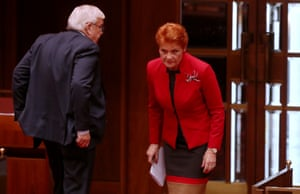 One Nation senators Pauline Hanson and Brian Burston leave the chamber as the Senate continues debating the changes to the marriage act