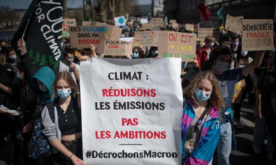 Protesters hold a banner reading 'Climate: let's reduce emissions, not our ambitions' at a demonstration in Nantes, France
