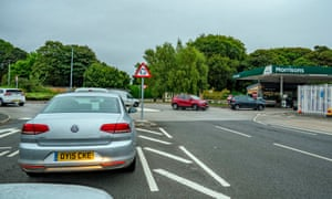 Motorists queue for petrol at the Morrisons petrol Station in Belle Vale, Liverpool this morning
