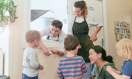 Head Chef Elena Coates and Sous Chef Liam Hughes with children at Little Jungle Nursery, south London