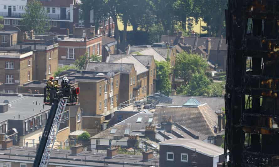 Fire service personnel survey the damage to Grenfell Tower. Forensic scientists will work to establish a point of origin for the devastating fire.