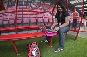 Bournemouth's club photographer Sophie Cook prepares her images before the Premier League game against West Bromwich Albion in May 2016.