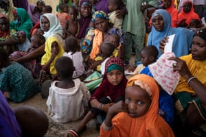 Mothers and children in Anka wait for a World Food Programme nutrition screening and food distribution
