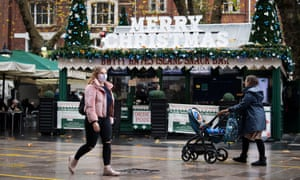 People walk past a cafe in Cardiff