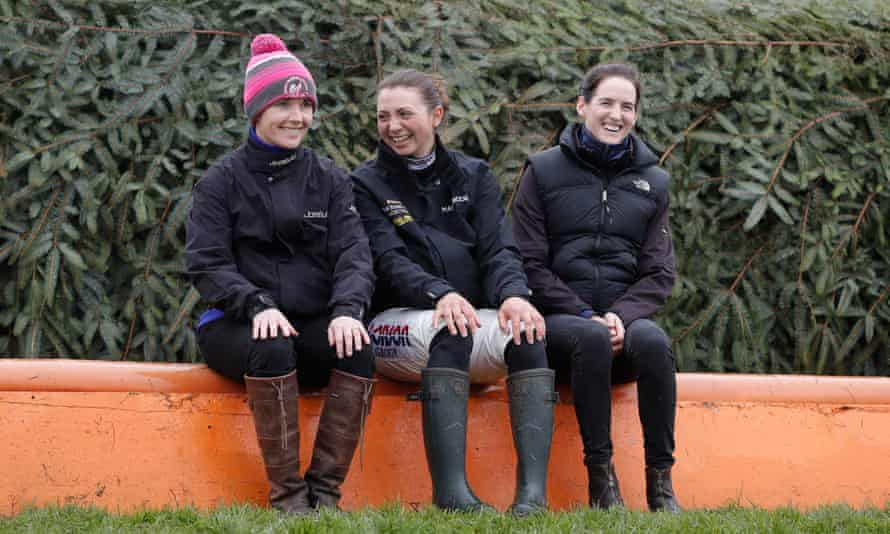 Katie Walsh, Bryony Frost and Rachael Blackmore sat in front of The Chair fence at Aintree.