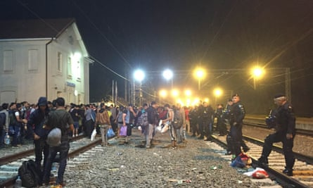 Refugees at Tovarnik station, Croatia, wait through the night for trains going west.