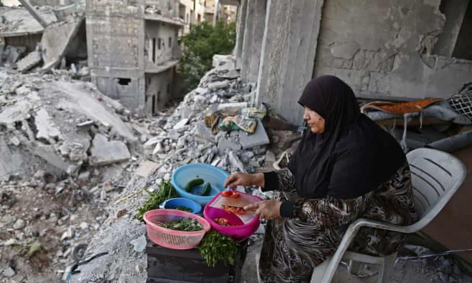 A Syrian woman cooks in Afrin. Displaced from their homes in Ghouta, families have sought refuge in abandoned houses in the traditionally Kurdish town