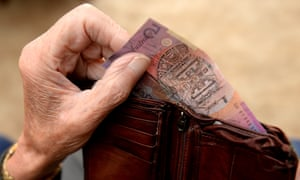 Money is taken out of a wallet in Canberra