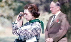 The Queen taking photographs at a horse show at Windsor in 1973.