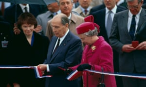 French President Francois Mitterrand and Queen Elizabeth cut the ribbon during the official opening ceremony of the channel tunnel, 1994.