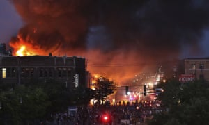 A large fire burns in Minneapolis during a third night of unrest following the death of George Floyd in police custody