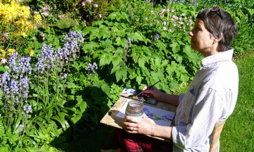 woman painting in garden