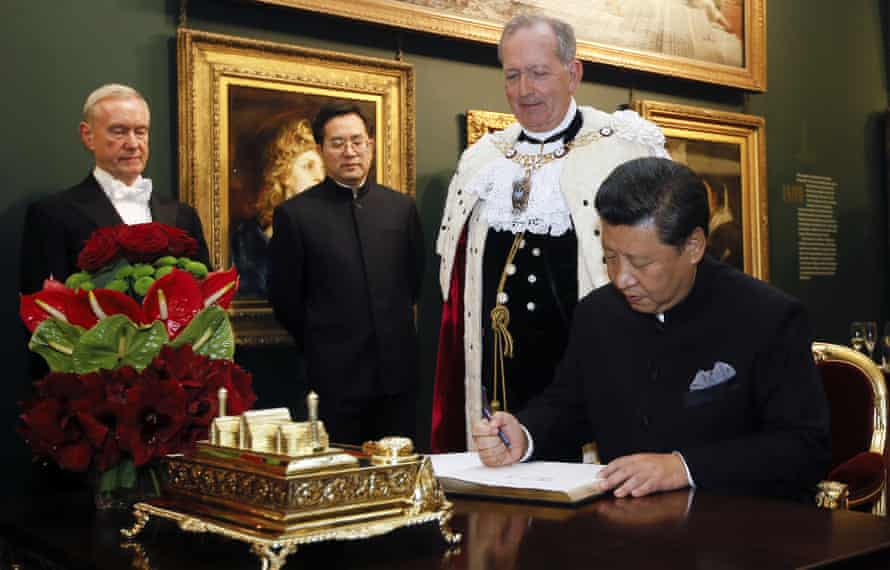 Xi signs the distinguished visitors book watched by the lord mayor of London, Alan Yarrow.