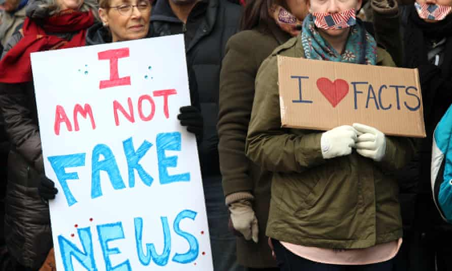 Activists stand in silence outside the New York Times' headquarters during the March for a Free Presss on 26 Feb 2017.