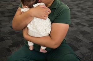 A mother cuddles her three-month-old baby who is at the prison for a rare visit.
