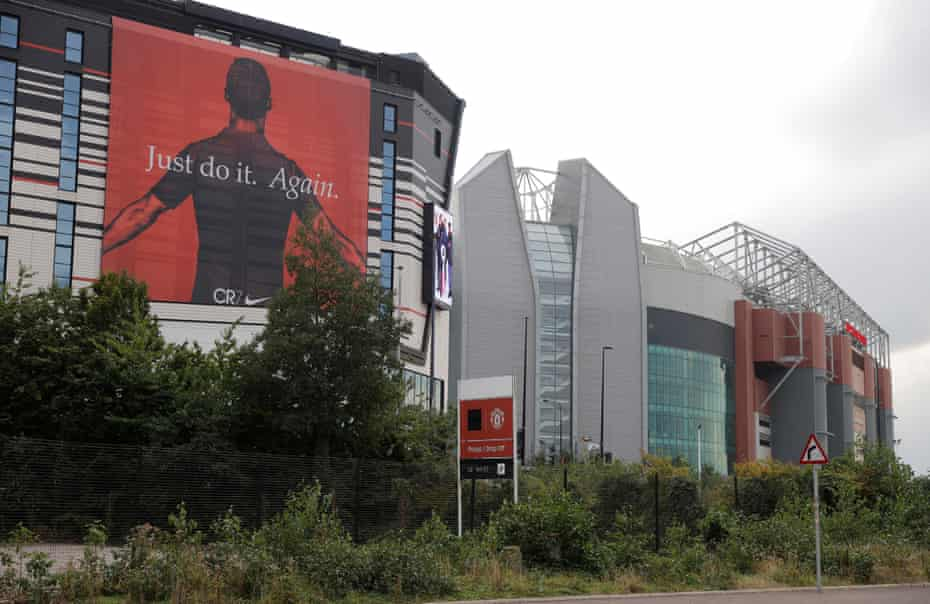 A huge Nike CR7 advertisement on the side of the Football Hotel in front of Old Trafford