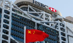 A Chinese national flag flies in front of HSBC headquarters in Hong Kong