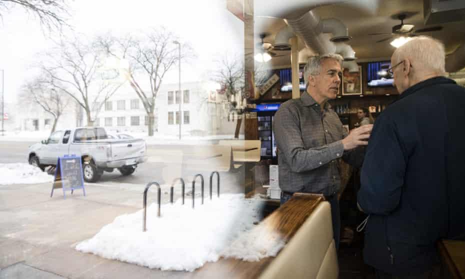 Walsh speaks to Ernie Rairdin at Riley's Cafe in Cedar Rapids, Iowa.
