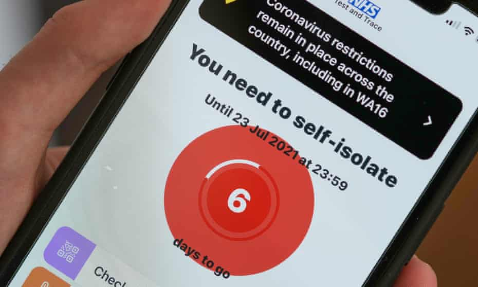 A mobile phone showing notification to self-isolate