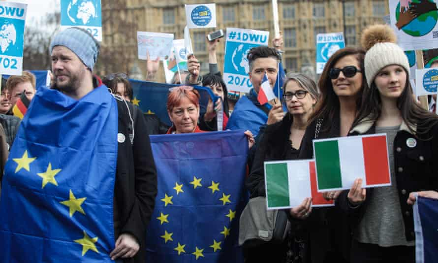 Protesters demonstrate outside parliament to highlight the contribution of migrant workers and EU citizens to the UK economy and to call on the government to guarantee their right to remain.