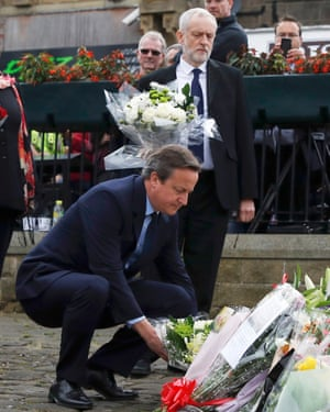 Jeremy Corbyn, Leader of the Labour Party and Britain's Prime Minister David Cameron leave tributes near the scene of the murder of Labour Member of Parliament Jo Cox in Birstal near Leeds