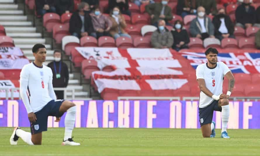 Jude Bellingham and Tyrone Mings of England take the knee before the friendly match between England and Austria at the Riverside Stadium  in Middlesbrough