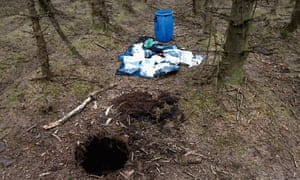 A barrel containing weapons, which was recovered at a 'terrorist hide' in Capanagh Forest near Larne.