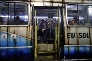 Revellers of União da Ilha samba school enact a crime on a bus at the Sambadrome