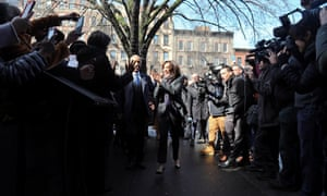 Civil rights leader Al Sharpton escorts Kamala Harris past media and well wishers as they arrive at Sylvia's Restaurant in the Harlem neighborhood of New York, 21 February 2019.