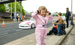 Mae Campbell, 4 years-old, stands by the track. The 2nd Coventry MotoFest took place over the weekend of 30-31st May 2015.