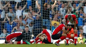 Dejected Southampton players on their knees after Everton's Tom Davies scored a 96th minute equaliser and pulling them back into a relegation battle at Goodison Park. The Saints meet fellow relegation battlers Swansea on Tuesday.