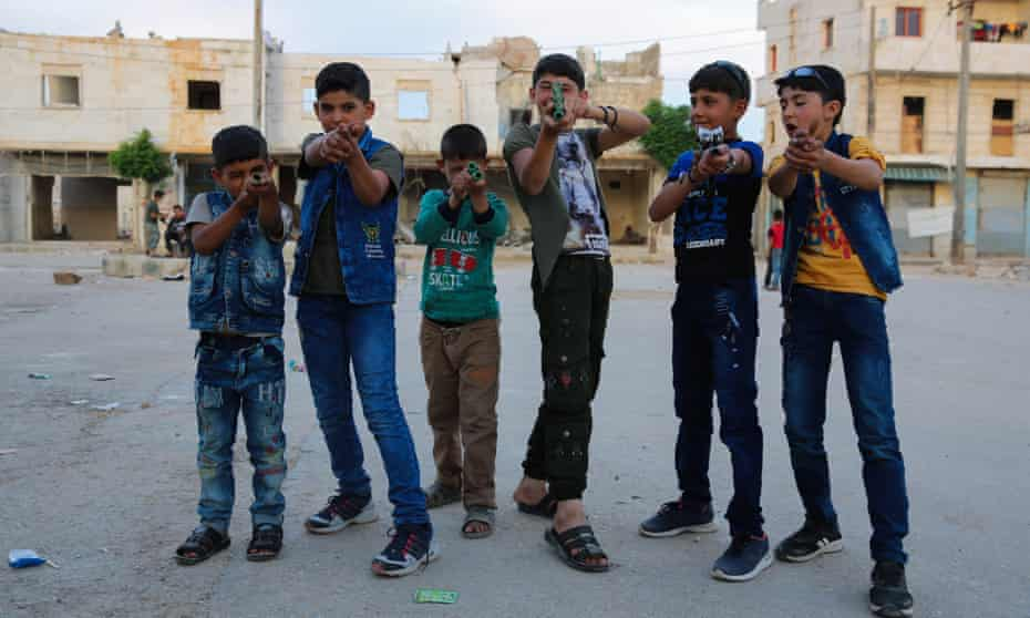 Children play with toy rifles