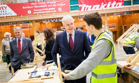 The Welsh Labour leader Carwyn Jones, second from right, visits apprentices and staff at Bridgend College.