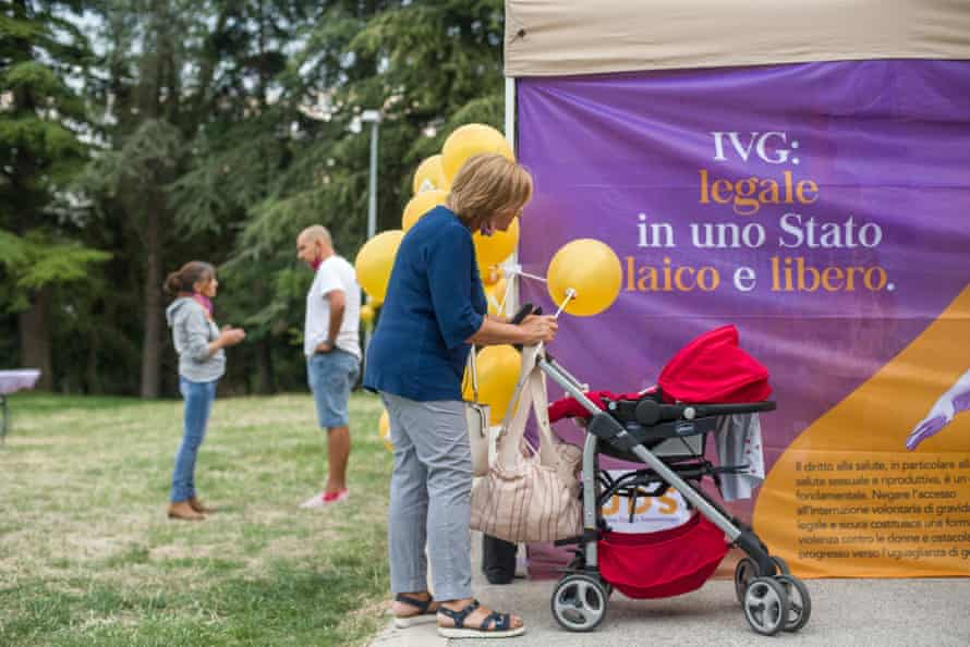 Visitors attend an event organised by the Sammarinese Women's Union, the association promoting the referendum.