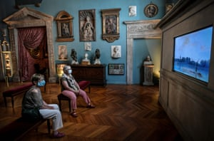 Visitors look at an installation at the Jacquemart- André Museum in Paris, France