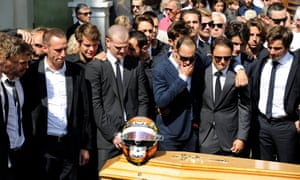 Formula One drivers pay their respects over the coffin of another French driver, Jules Bianchi, who died from injuries sustained at the 2014 Japanese Grand Prix.