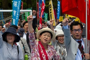 Tokyo, Japan Demonstrators call for an end to overwork and urge PM Shinzō Abe to ditch plans to amend the constitution to allow overseas military forays