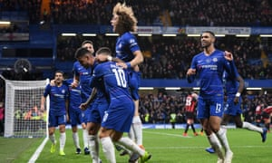 Eden Hazard of Chelsea celebrates with team mates.